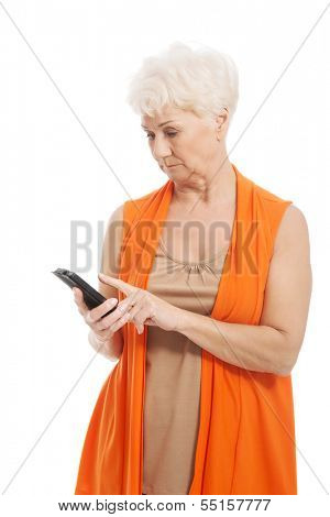 An old lady using mobile phone. Isolated on white.
