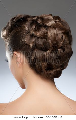 Portrait of pretty young woman with fashion braid hairstyle