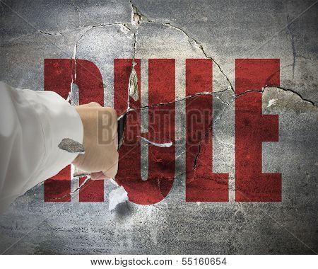 Punching, Break Concrete Wall With Word Rule On It, Break The Rule.