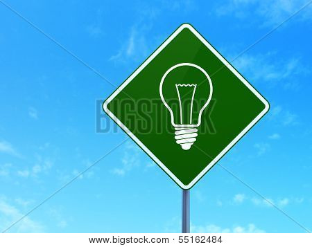 Business concept: Light Bulb on road sign background