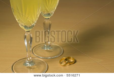 Champagne Glasses With Wedding Rings.