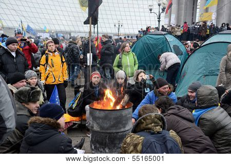 KIEV, UKRAINE - DECEMBER 08: Mass meeting of millions for the government's resignation, protesters are heated by the fire, December 08, 2013,  Independence Square (Maydan) in Kiev