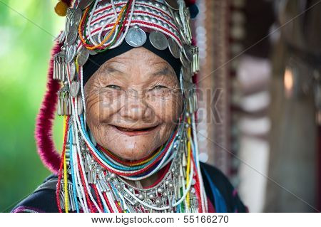 CHIANG RAI, THAILAND - DEC 4: Unidentified Akha tribe elderly woman with traditional clothes and silver jewelery in hill tribe minority village on December 4, 2013. Mae Hong Son, Thailand.
