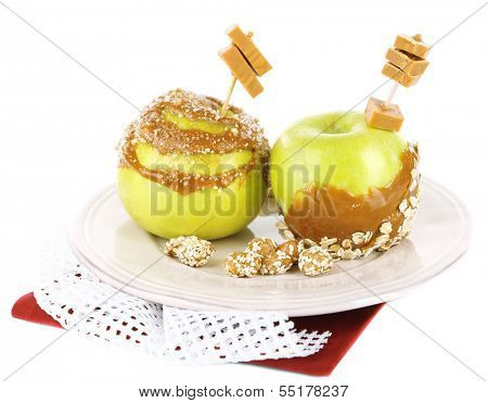 Homemade taffy apples, isolated on white