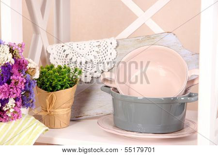 Tableware and decor, on bright background, close-up
