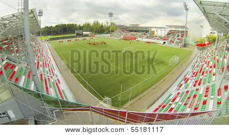 MOSCOW - SEP 11: (view from unmanned quadrocopter) Football players at small Sports Aren ofa stadium Locomotive, on Sep 11, 2013 in Moscow, Russia. Locomotive Stadium was built in 2000-2002.