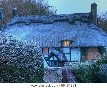 Thatched Cottage with Snow