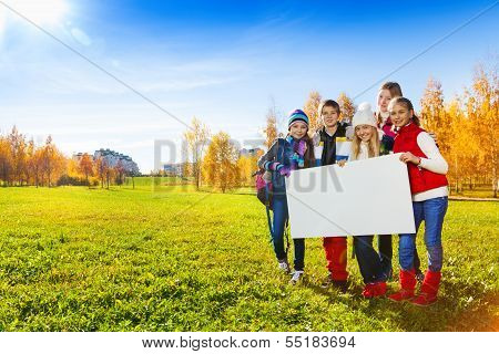 Teenagers With Blank Banner