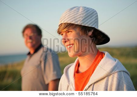 Smiling teen with father