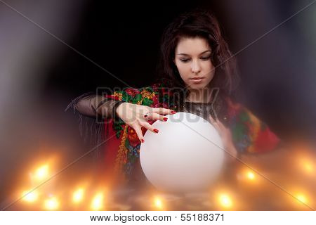 Witch with magic crystal ball