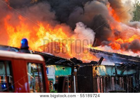 Burning ruins of building in city
