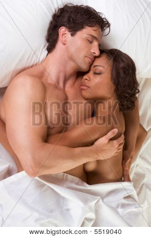 Young Couple Naked Man And Woman Sleeping In Bed