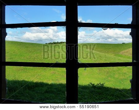 View Through A Broken Window Onto Meadows