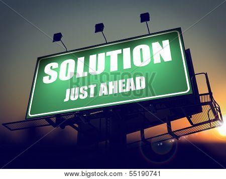 Solution Just Ahead on Green Billboard.