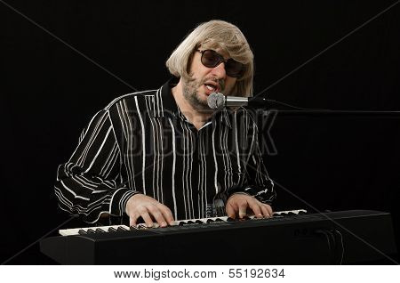 Singer Accompanies Himself On Electric Piano
