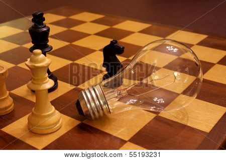 Chess Pieces & Light Bulb Concept