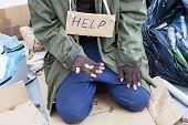 stock photo of beggars  - Poor homeless beggar on the street of town - JPG
