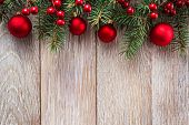 pic of snow border  - Christmas red bauble border on wooden background - JPG