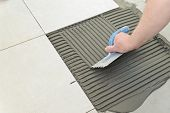 stock photo of concrete  - Laying Ceramic Tiles - JPG