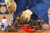 stock photo of carburetor  - Repair of parts car engine in the workshop - JPG
