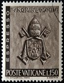 A stamp printed in Vatican shows Vatican Papal Coat of Arms Paul VI