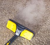 stock photo of mites  - Using dry steam cleaner to sanitize floor carpet - JPG