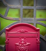 stock photo of mailbox  - Cloes up of a mailbox on the street with fence - JPG