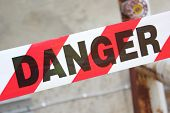 stock photo of hazard symbol  - Danger tape being used as a sign to warn people not to enter area as it is dangerous - JPG