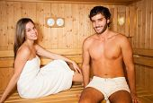 Couple having a sauna bath in a steam room