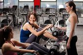 stock photo of rep  - Pretty female Latin friends talking and having fun during a break at the gym - JPG