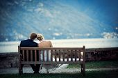 Young newly wed couple on a bench