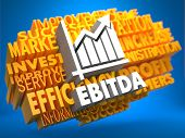 image of amortization  - EBITDA with Growth Chart Icon on Yellow WordCloud on Blue Background - JPG