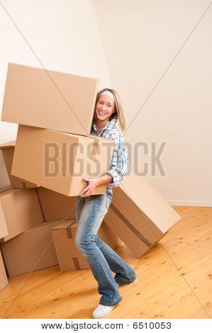 Moving House: Woman Holding Heavy Carton Box