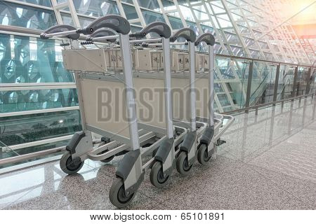 Luggage cart at modern airport.
