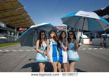 SEPANG, MALAYSIA - MAY 11, 2014: The Race Queens of the Thailand Super Series grace the the start grid before the race at the Super 2000 race held in Sepang International Circuit, Malaysia.