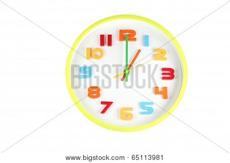 Colorful Clock In Telling Time Of One O'clock.