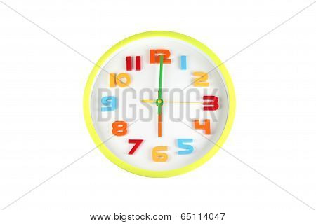 Colorful Clock In Telling Time Of Six O'clock.