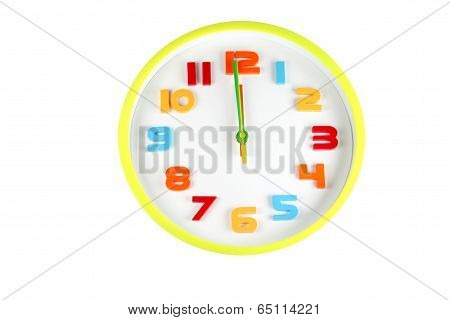 Colorful Clock In Telling Time Of Twelve O'clock.