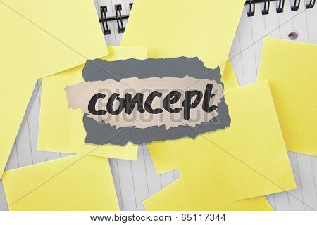 The word concept against sticky notes strewn over notepad