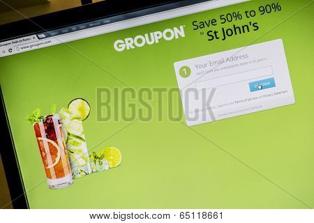 Ostersund, Sweden - May 15, 2014: Groupon website displayed on a computer screen. Groupon is a deal-of-the-day website that features discounted gift certificates usable at local or national companies.