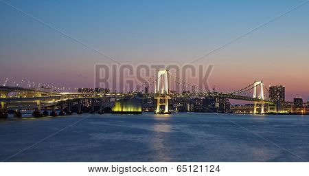 view of tokyo bay and rainbow bridge at twilight