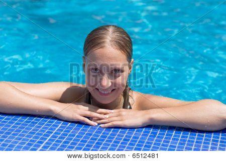Blond girl in swimming pool
