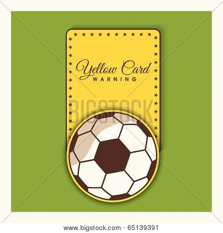 Shiny soccer ball with foul yellow card on green background.