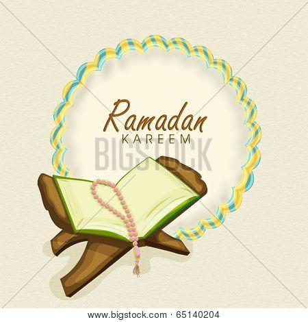 Open islamic holy book Quran Shareef with prayer beads and stylish text Ramadan Mubarak .