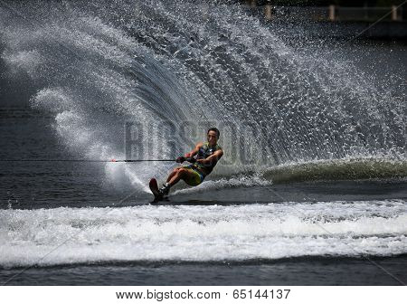 PUTRAJAYA, MALAYSIA - APRIL 26, 2014: Maasaki Hamada of Japan rides the waves at the Slalom Open event at the Putrajaya Nautique Ski & Wake Championship 2014.