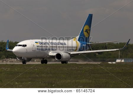 Ukraine International Airlines Boeing 737-500 aircraft preparing for take-off from the runway