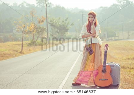 Hippie Girl Using Mobile Phone