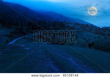 Cloud Fog On Top Of Mountains At Night