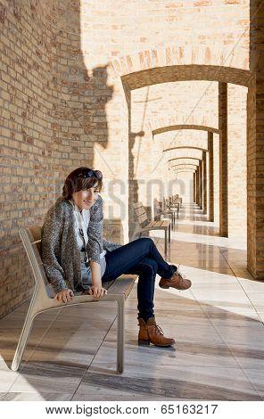 Pretty Woman Posing On A Bench