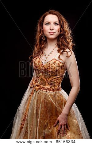 woman in pastel gold dress on black background